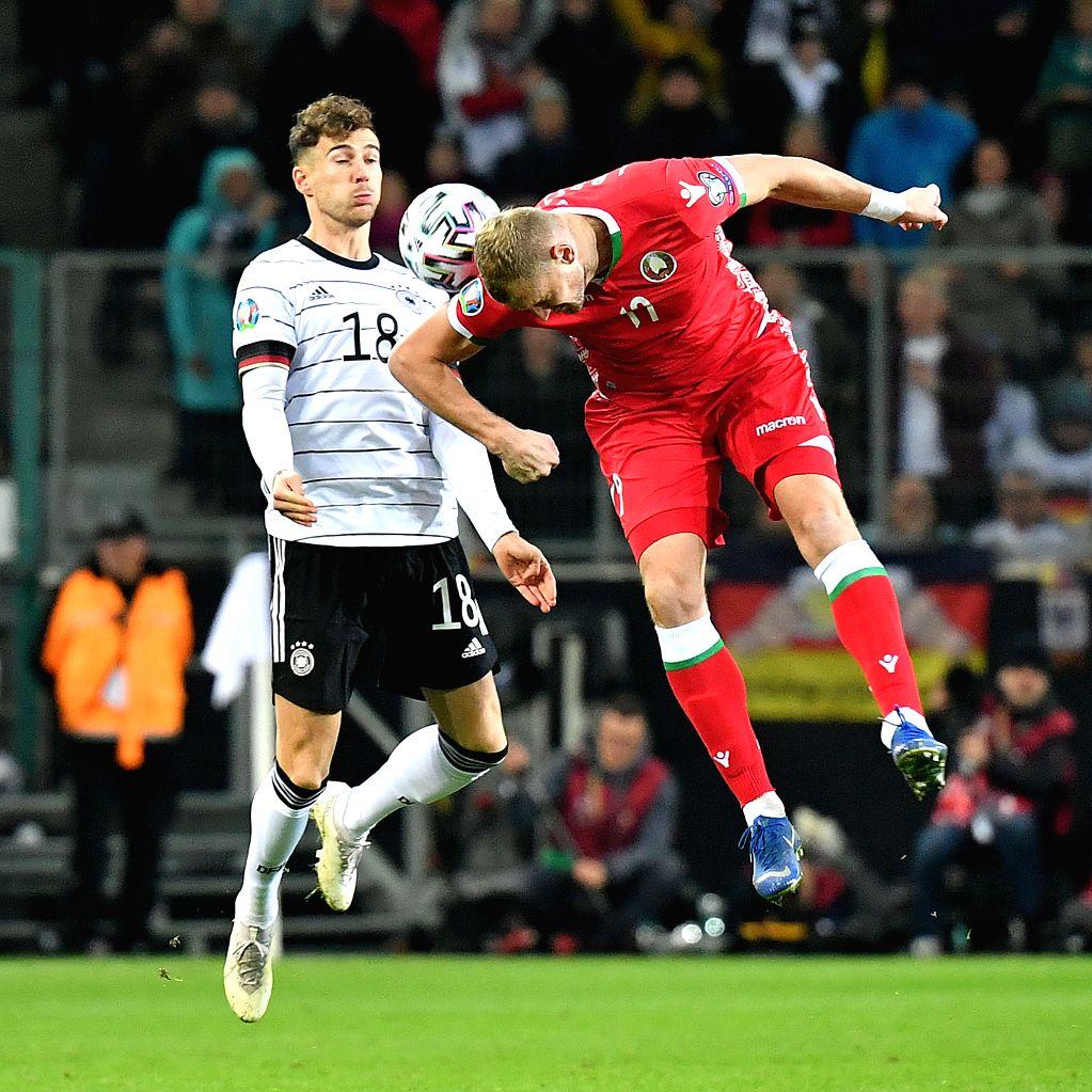 MONCHENGLADBACH, Nov. 17, 2019 - Leon Goretzka (L) of Germany vies with Denis Laptev of Belarus during their UEFA Euro 2020 group C qualifying match in Monchengladbach, Germany, Nov. 16, 2019. ...