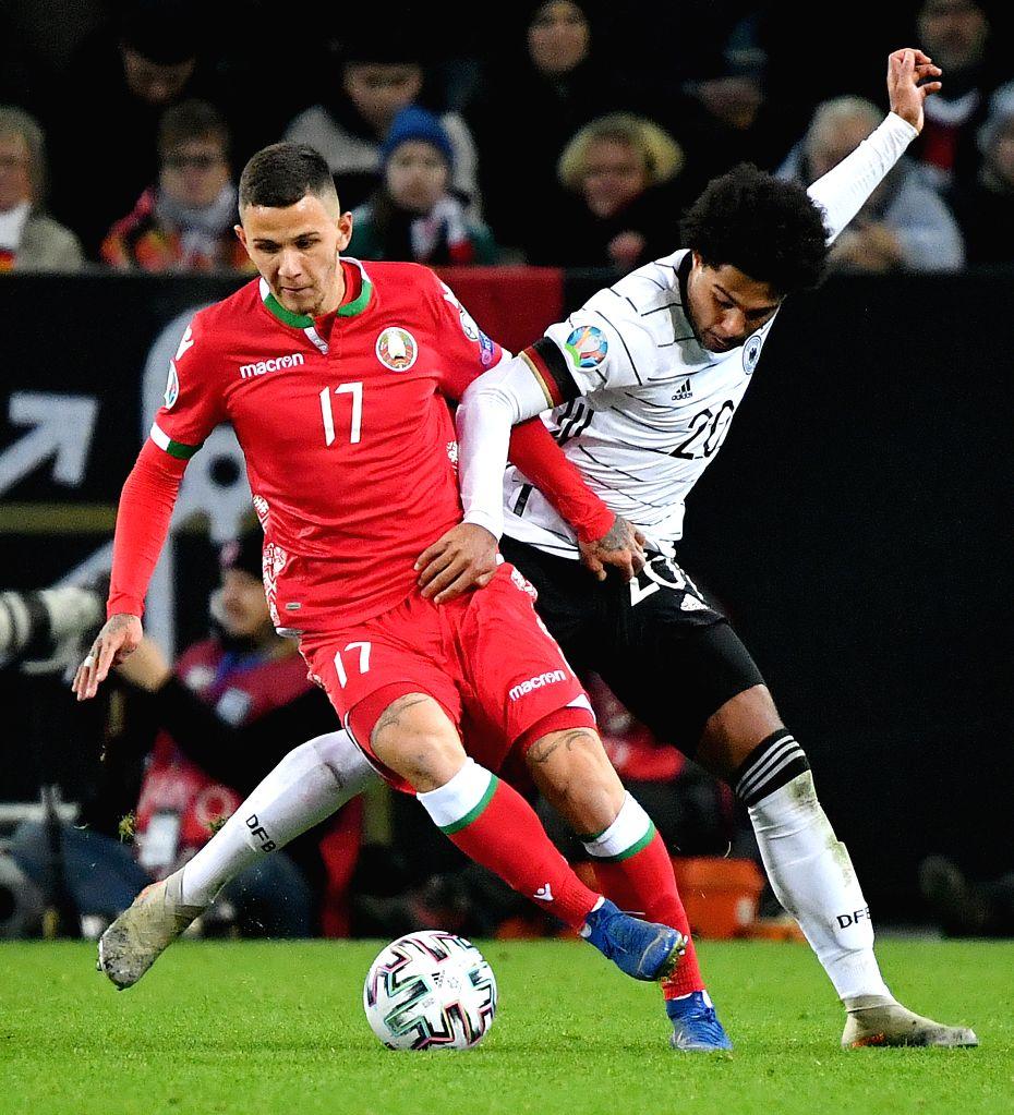 MONCHENGLADBACH, Nov. 17, 2019 - Serge Gnabry (R) of Germany vies with Vitali Lisakovich of Belarus during their UEFA Euro 2020 group C qualifying match in Monchengladbach, Germany, Nov. 16, 2019. ...