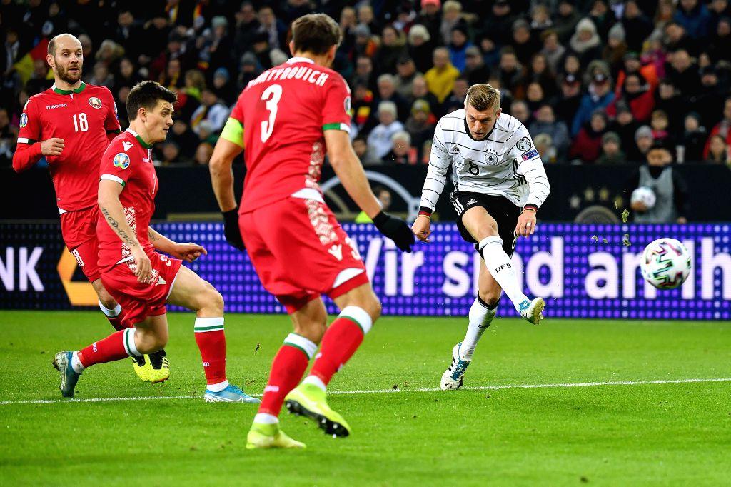 MONCHENGLADBACH, Nov. 17, 2019 - Toni Kroos (1st R) of Germany shoots during the UEFA Euro 2020 group C qualifying match against  Belarus in Monchengladbach, Germany, Nov. 16, 2019. Germany won 4-0.