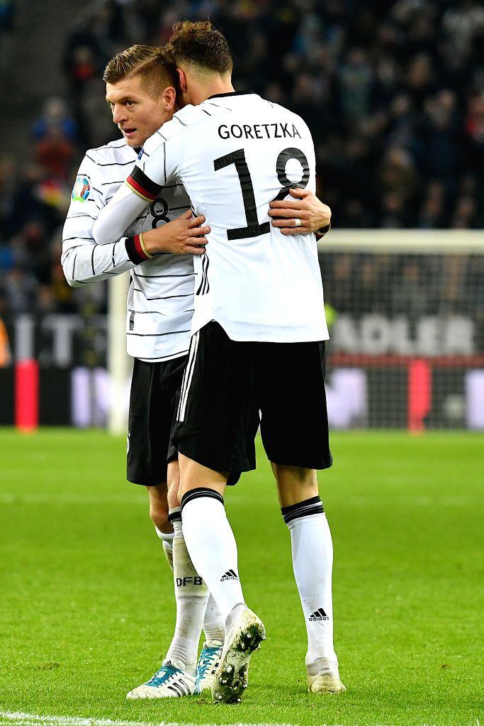 MONCHENGLADBACH, Nov. 17, 2019 - Toni Kroos (L) of Germany celebrates scoring with his teammate Leon Goretzka during their UEFA Euro 2020 group C qualifying match against Belarus in Monchengladbach, ...