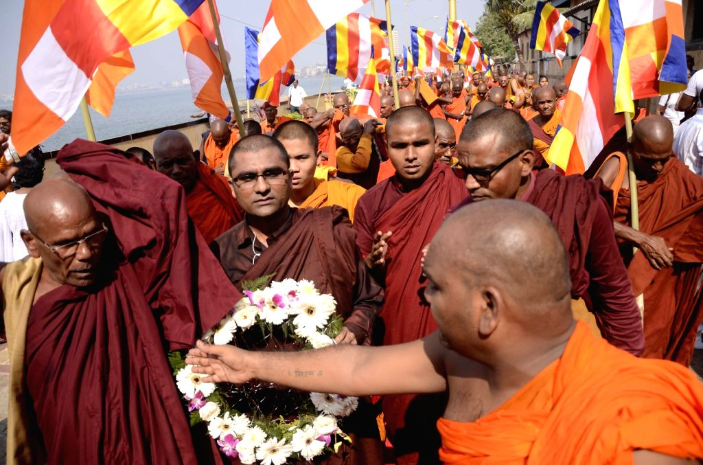Monks assemble at Chaitya Bhoomi to pay tribute to B R Ambedkar on his death anniversary in Mumbai on Dec.6, 2013.