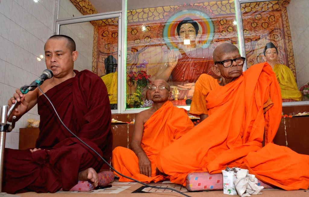 Monks at a monastery on 2558th birth anniversary of Lord Buddha in Guwahati on May 14, 2014. Buddha Purnima is the most sacred day in the Buddhist calendar and celebrated on the full-moon day of ...
