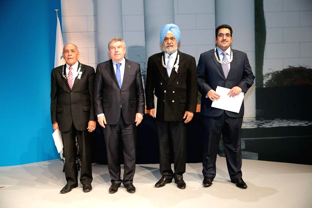 Monte Carlo: International Olympic Committee  (IOC) President Thomas Bach (second from left) with Indian Olympic Association (IOA) secretary general Randhir Singh (third from left) during the two-day