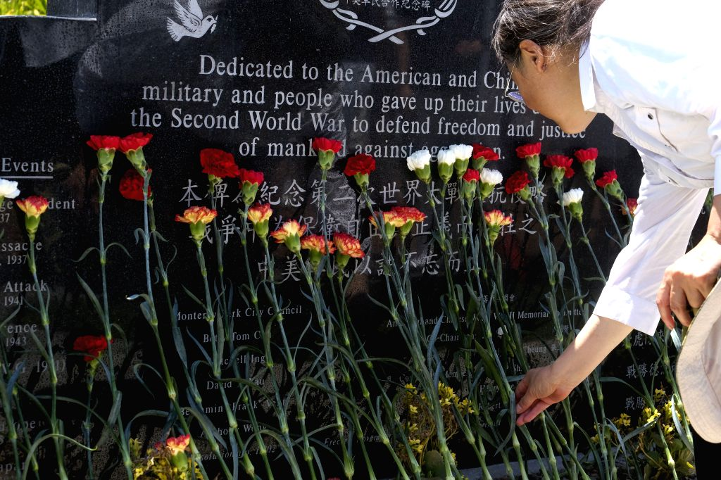 MONTEREY PARK (UNITED STATES), July 8, 2018 A man pays tribute during a memorial ceremony to commemorate the 81st anniversary of Lugou Bridge Incident, in Monterey Park, California, the ...