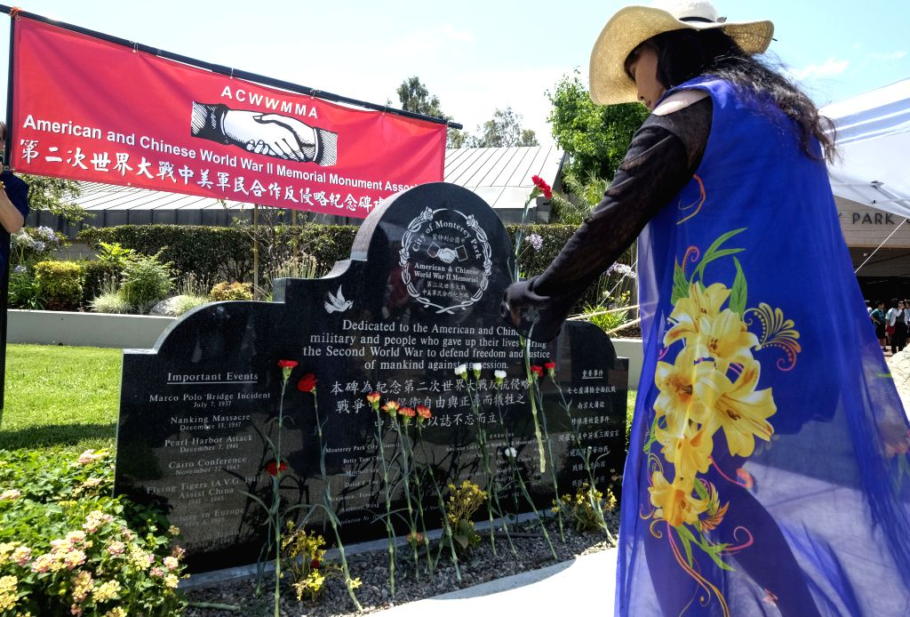 MONTEREY PARK (UNITED STATES), July 8, 2018 A woman pays tribute during a memorial ceremony to commemorate the 81st anniversary of Lugou Bridge Incident, in Monterey Park, California, the ...