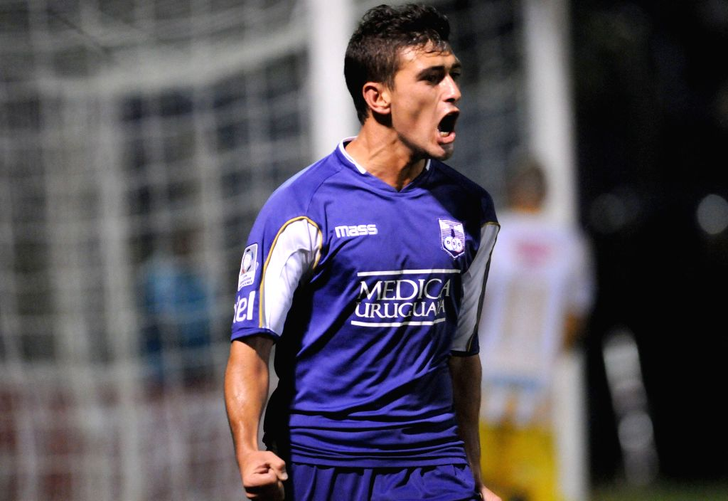 Giorgian De Arrascaeta of Uruguay's Defensor Sporting celebrates scoring against Bolivia's the Strongest during the knockout stage match of Libertadores Cup ...