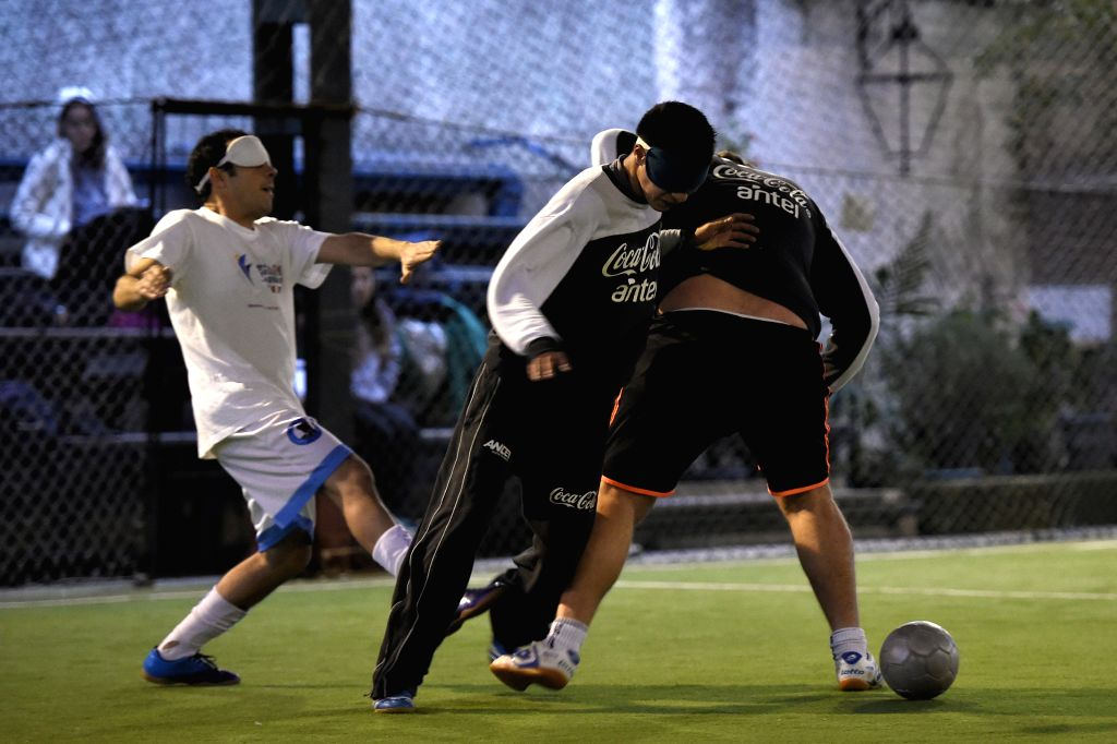 Players of the Uruguayan national soccer team of blind people vie during a training session in Montevideo, capital of Uruguay, Aug. 12, 2014. In 1986, the first .