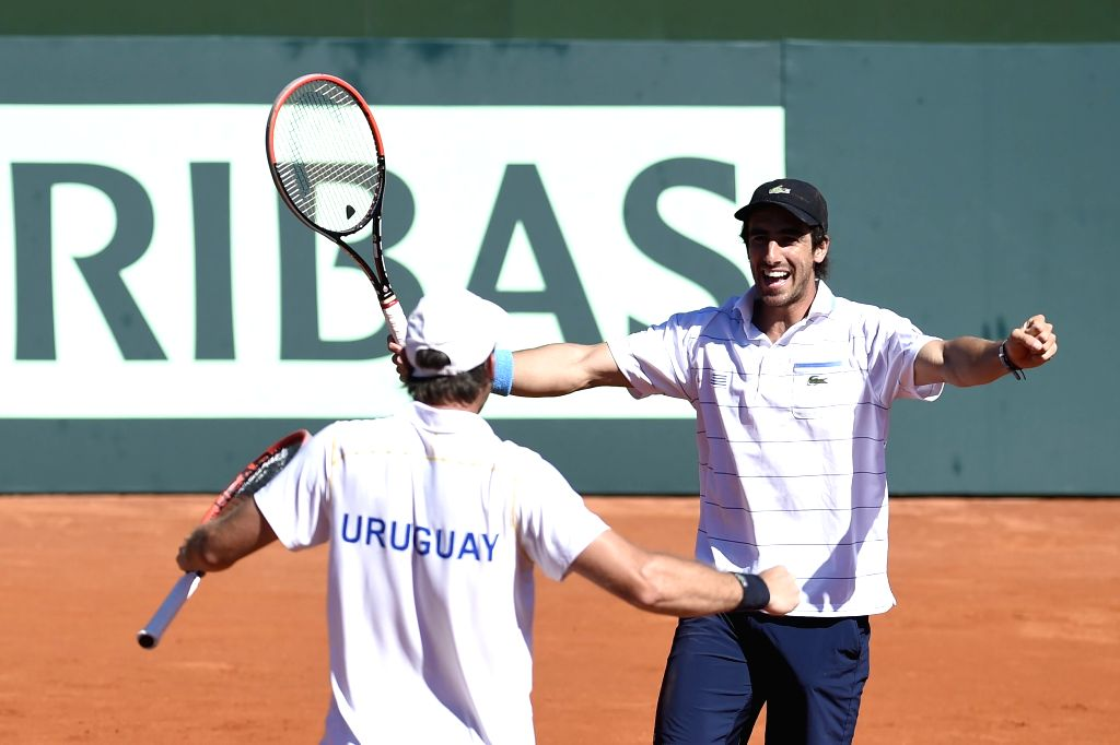 Uruguayan players Martin Cuevas (L) and Pablo Cuevas celebrate the victory after the Davis Cup Group 1 of American Zone doubles match against Colombia's Juan ...