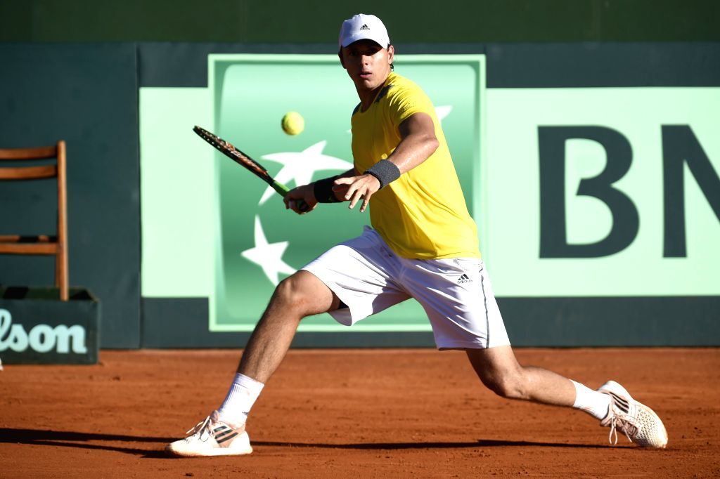 Colombia's Alejandro Gonzalez returns the ball during the men's singles match of the Group 1 of the American Zone of the Davis Cup against Uruguay's Martin ...