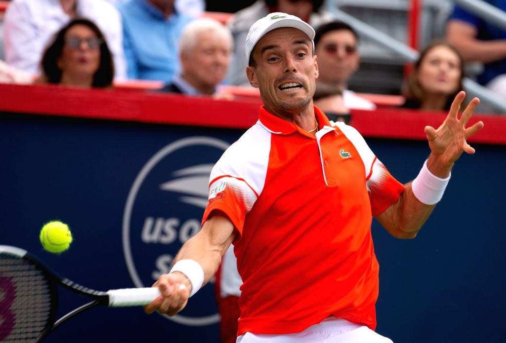 MONTREAL, Aug. 11, 2019 - Roberto Bautista Agut of Spain returns the ball during the men's singles quarterfinal match between Gael Monfils of France and Roberto Bautista Agut of Spain at the 2019 ...