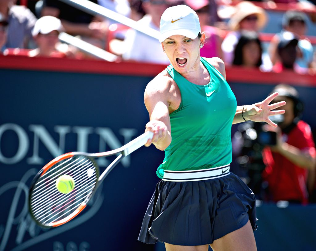 MONTREAL, Aug. 12, 2018 - Simona Halep of Romania returns the ball to Ashleigh Barty of Australia during the semifinal match of women's singles at the 2018 Rogers Cup in Montreal, Aug. 11, 2018. ...