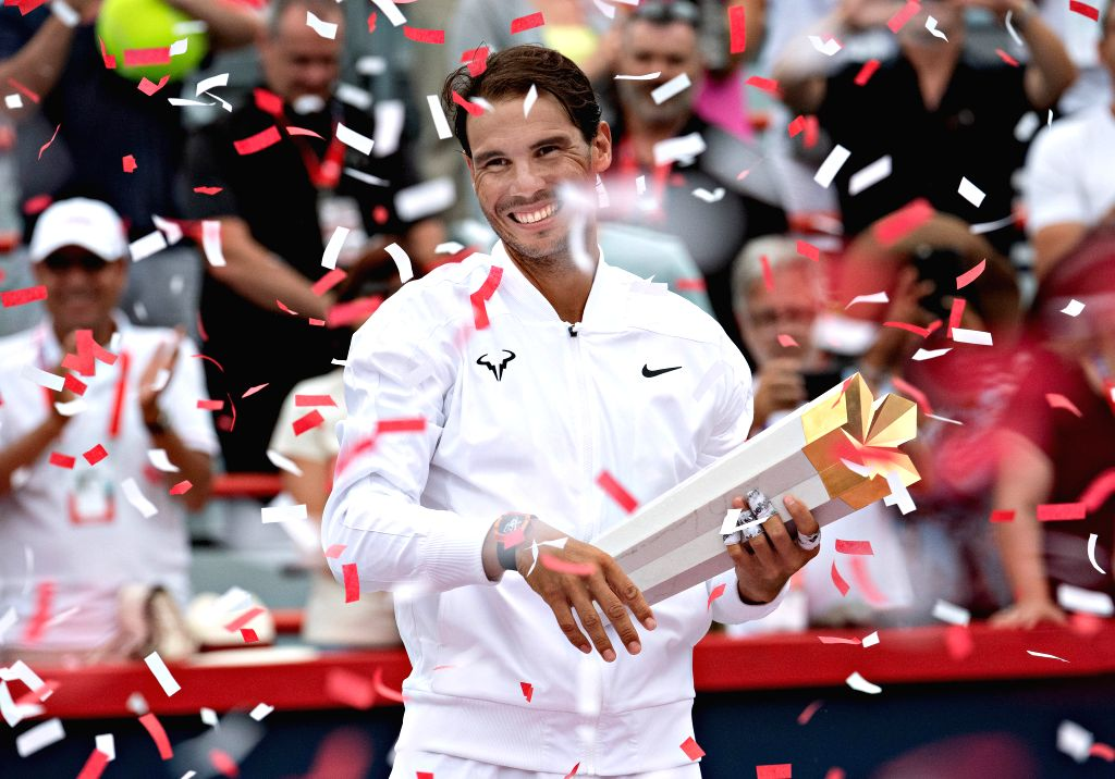 MONTREAL, Aug. 12, 2019 - Rafael Nadal of Spain celebrates during the awarding ceremony after defeating Daniil Medvedev of Russia in during the final of the Rogers Cup tennis tournament in Montreal, ...