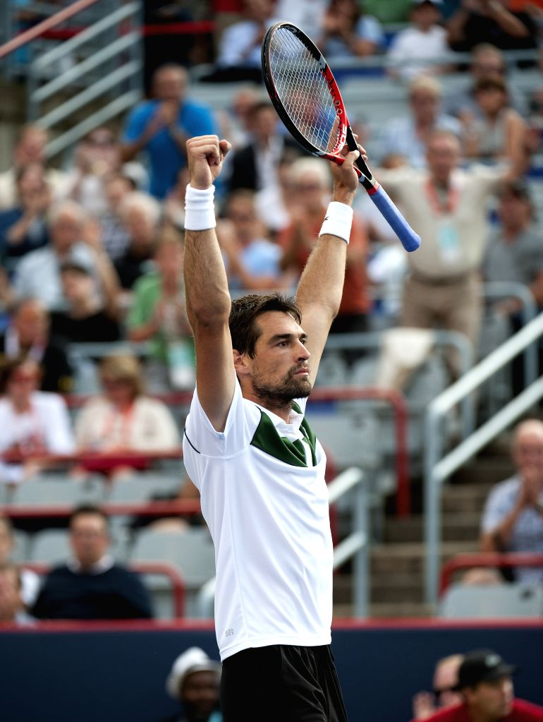 Jeremy Chardy of France celebrates after winning his quarterfinal match of men's singles against John Isner of the United States at the 2015 Rogers Cup in Montreal, ...