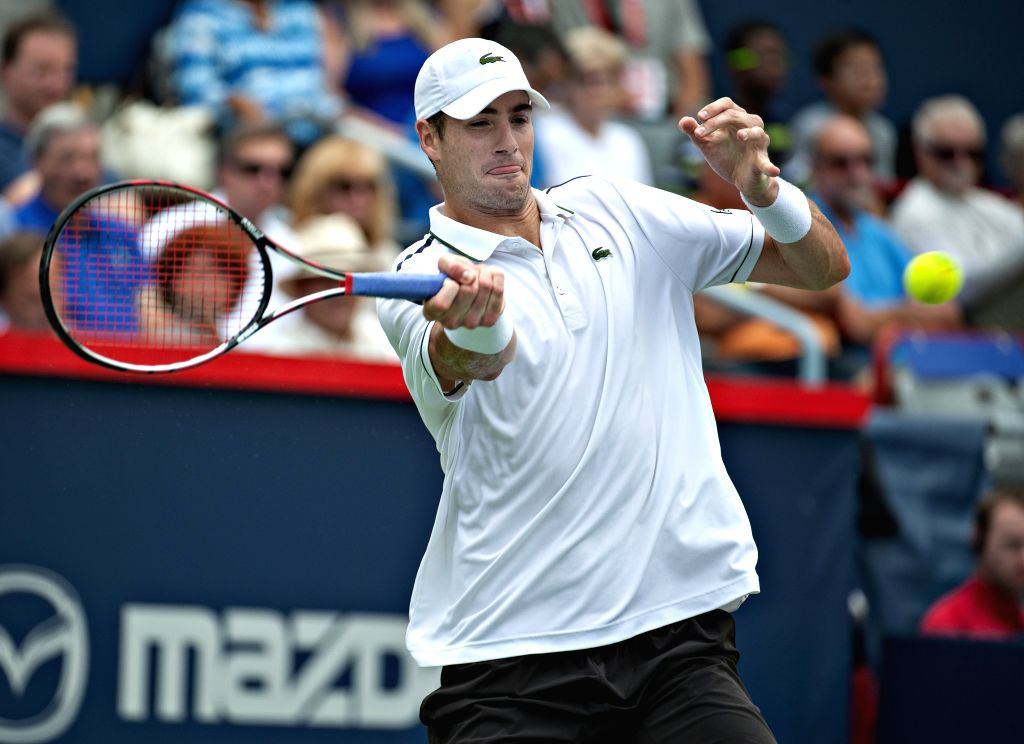 John Isner of the United States returns the ball to Jeremy Chardy of France during the quarterfinal match of men's singles at the 2015 Rogers Cup in Montreal, ...