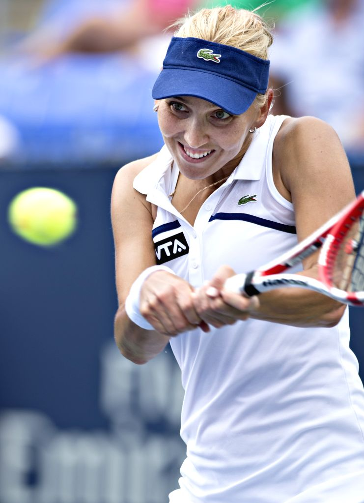 Russia's Elena Vesnina returns the ball against Italy's Camila Giorgi during the Canadian Open Rogers Cup in Montreal on Aug. 5, 2014. Vesnina won 2-1. ...