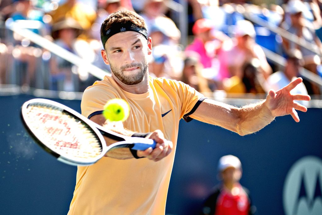 MONTREAL, Aug. 6, 2019 (Xinhua) -- Grigor Dimitrov of Bulgaria returns the ball during the first round of men's singles match against Stan Wawrinka of Switzerland at the 2019 Rogers Cup in Montreal, Canada, Aug. 5, 2019. (Xinhua/Andrew Soong/IANS)