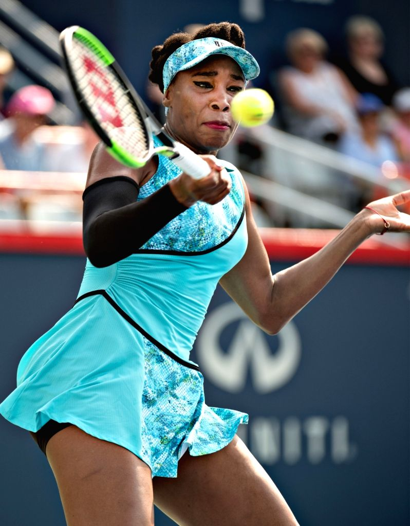 MONTREAL, Aug. 7, 2018 - Venus Williams of the United States hits a return during the first round of women's singles match against Caroline Dolehide of the United States at the 2018 Rogers Cup in ...