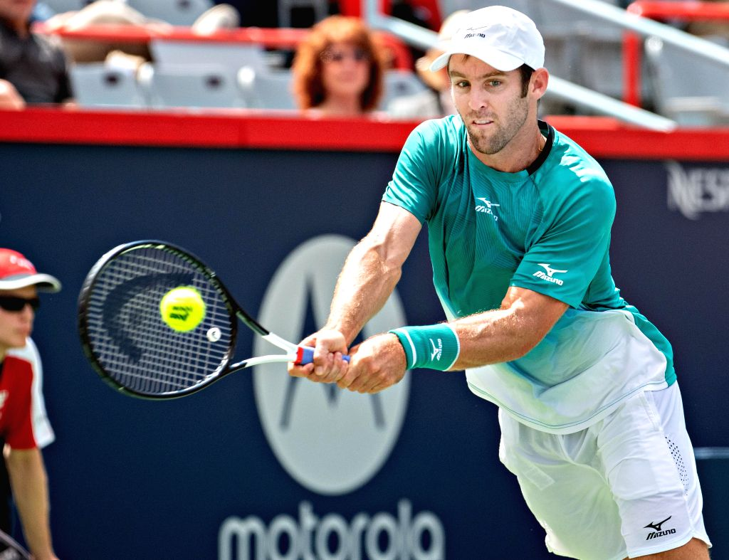 MONTREAL, Aug. 7, 2019 - Bradley Klahn of the United States returns the ball during the first round of men's singles match against Marin Cilic of Croatia at the 2019 Rogers Cup in Montreal, Canada, ...