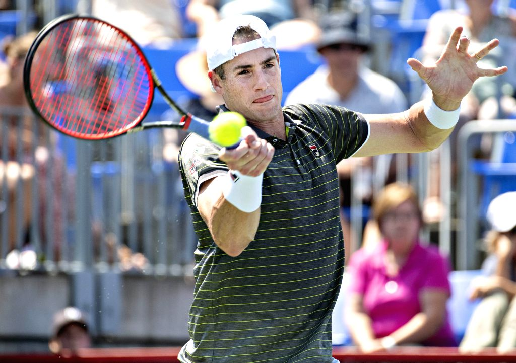 MONTREAL, Aug. 7, 2019 - John Isner of the United States returns the ball during the men's singles first round match between John Isner of the United States and Jordan Thompson of Australia at the ...