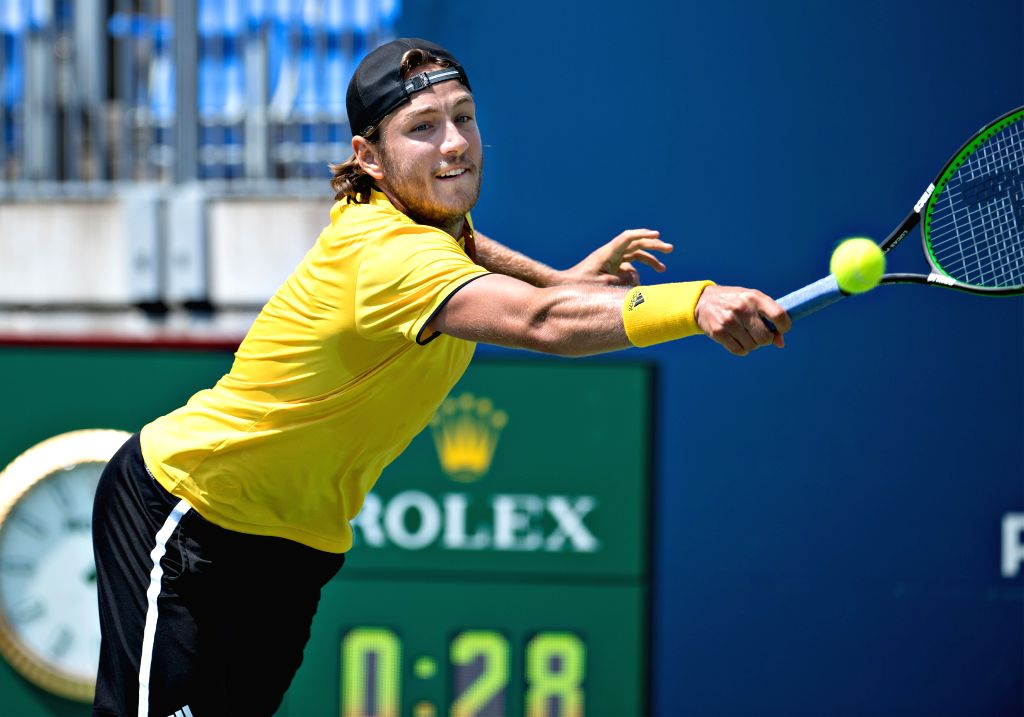 MONTREAL, Aug. 8, 2017 - Lucas Pouille of France hits a return during the men's singles first round match against Jared Donaldson of the United States at the 2017 Rogers Cup in Montreal, Canada, Aug. ...