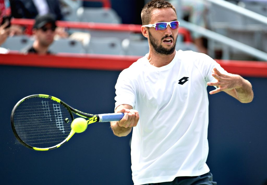 MONTREAL, Aug. 8, 2017 - Victor Troicki of Serbia hits a return during the men's singles first round match against Nick Kyrgios of Australia at the 2017 Rogers Cup in Montreal, Canada, Aug. 7, 2017. ...