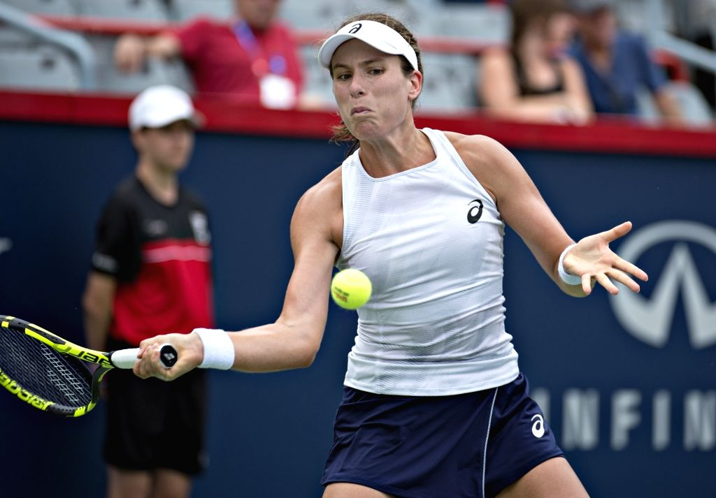 MONTREAL, Aug. 8, 2018 - Johanna Konta of Britain hits a return during the first round of women's singles match against Jelena Ostapenko of Latvia at the 2018 Rogers Cup in Montreal, Canada, Aug. 7, ...