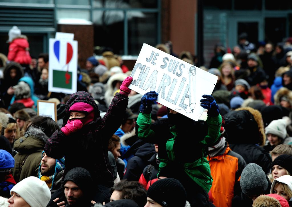 People rally in honor of the 17 victims killed during the three days deadly terrorist attack in France and for unity with France in downtown of Montreal, Canada, ..