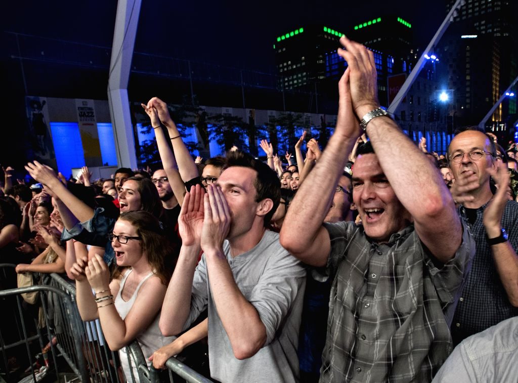 People admire French singer 'Woodkid' Yoanne Lemoine's performance during the Montreal International Jazz Festival in Montreal, Canada, on June 26, 2014. The 35th .