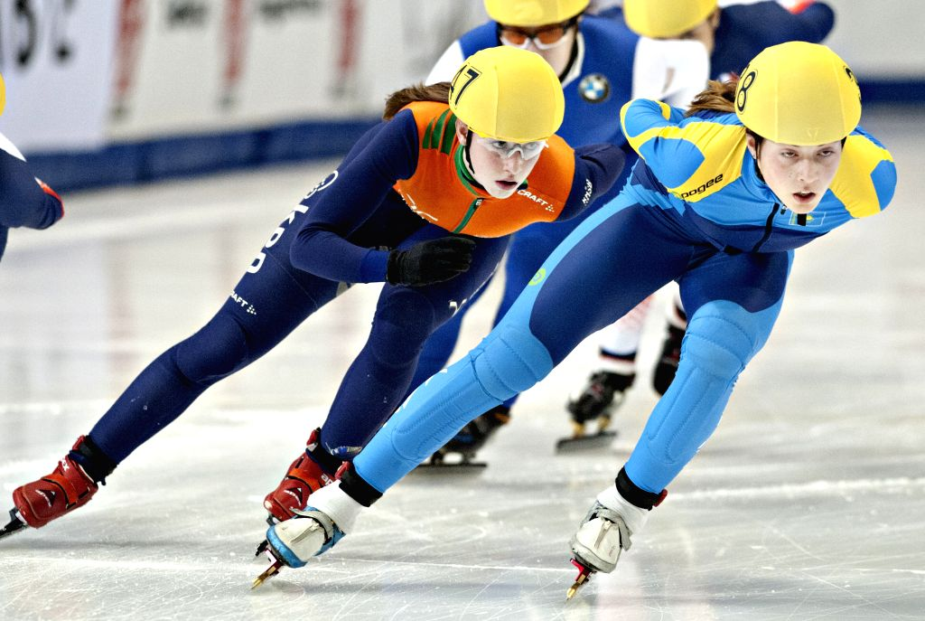 Suzanne Schulting of Netherlands (L) and Olga Tikhonova of Kazakstan compete in the women's Repechage round at the ISU Short Track Speed Skating World Cup in Montreal, Canada, Nov. 15, ...