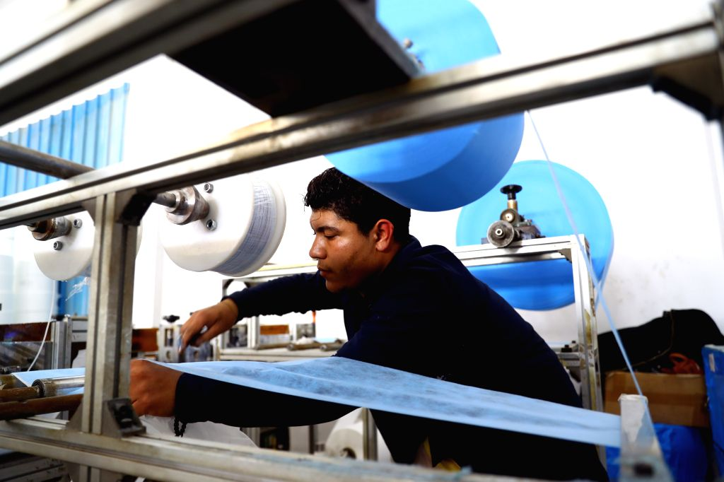 MONUFIA (EGYPT), March 19, 2020 A man works in a factory that produces face masks in Monufia, Egypt, on March 19, 2020. Egypt's largest factory of disposable medical products has more ...