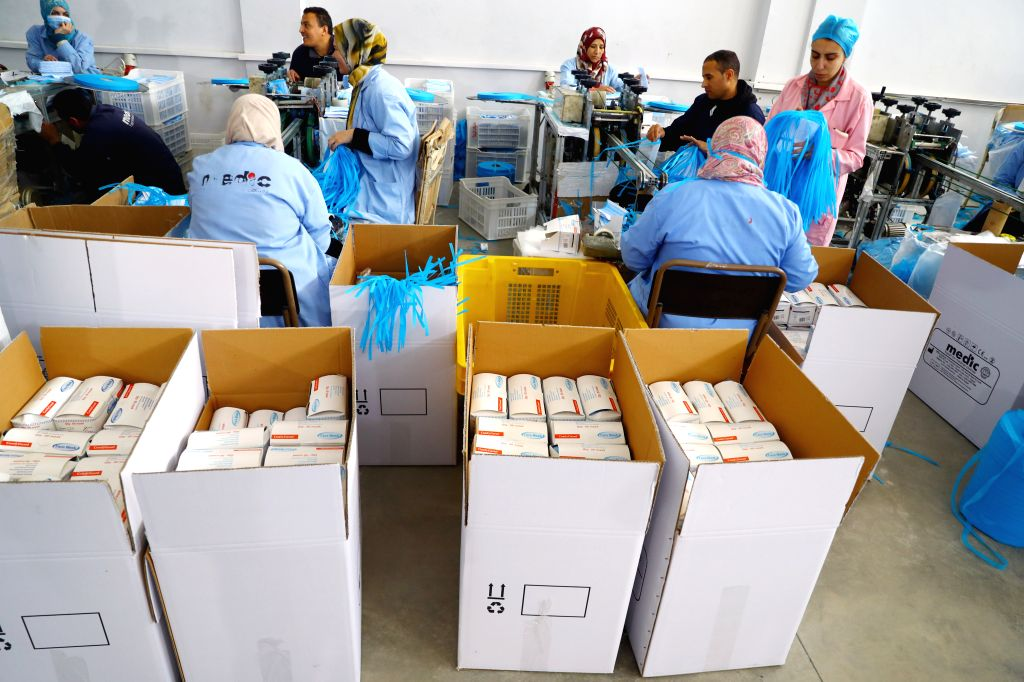 MONUFIA (EGYPT), March 19, 2020 People work in a factory that produces face masks in Monufia, Egypt, on March 19, 2020. Egypt's largest factory of disposable medical products has more ...