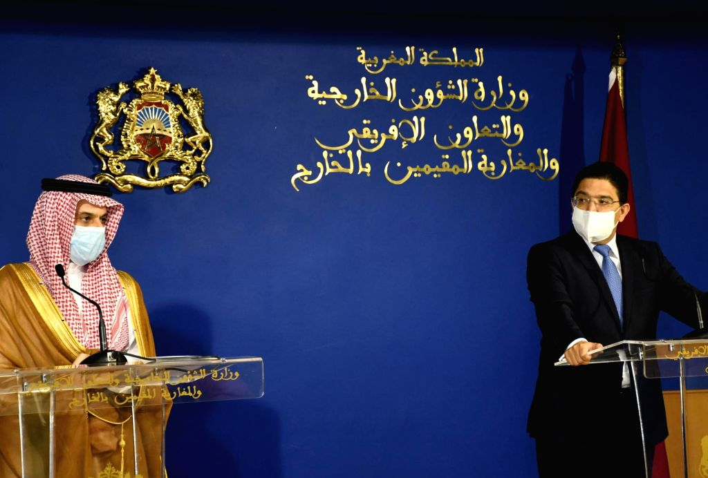 Morocco's Foreign Minister Nasser Bourita (R) and his Saudi counterpart Faisal bin Farhan Al Saud attend a joint press conference in Rabat, Morocco, on July 29, 2020. ... - Nasser Bourita