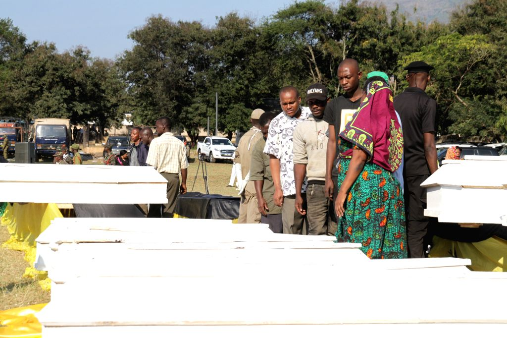 MOROGORO, Aug. 11, 2019 - People attend a burial ceremony for victims of a tanker explosion in Morogoro, Tanzania on Aug. 11, 2019. Tanzanian President John Magufuli has declared three days of ...