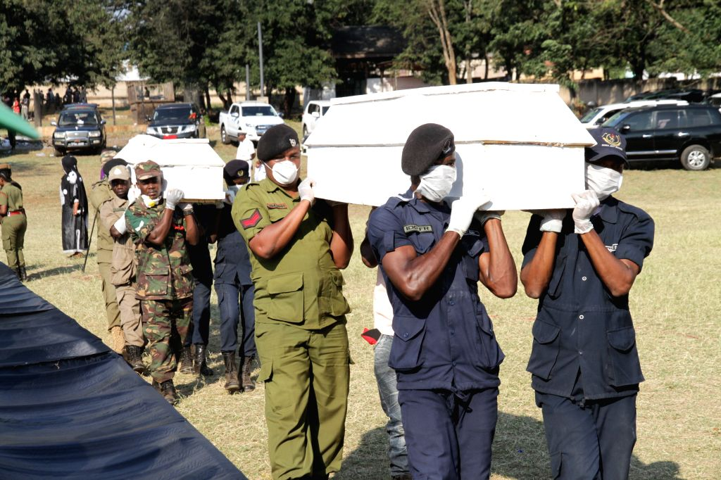 MOROGORO, Aug. 11, 2019 - Photo taken on Aug. 11, 2019 shows the burial ceremony for victims of a tanker explosion in Morogoro, Tanzania. Tanzanian President John Magufuli has declared three days of ...