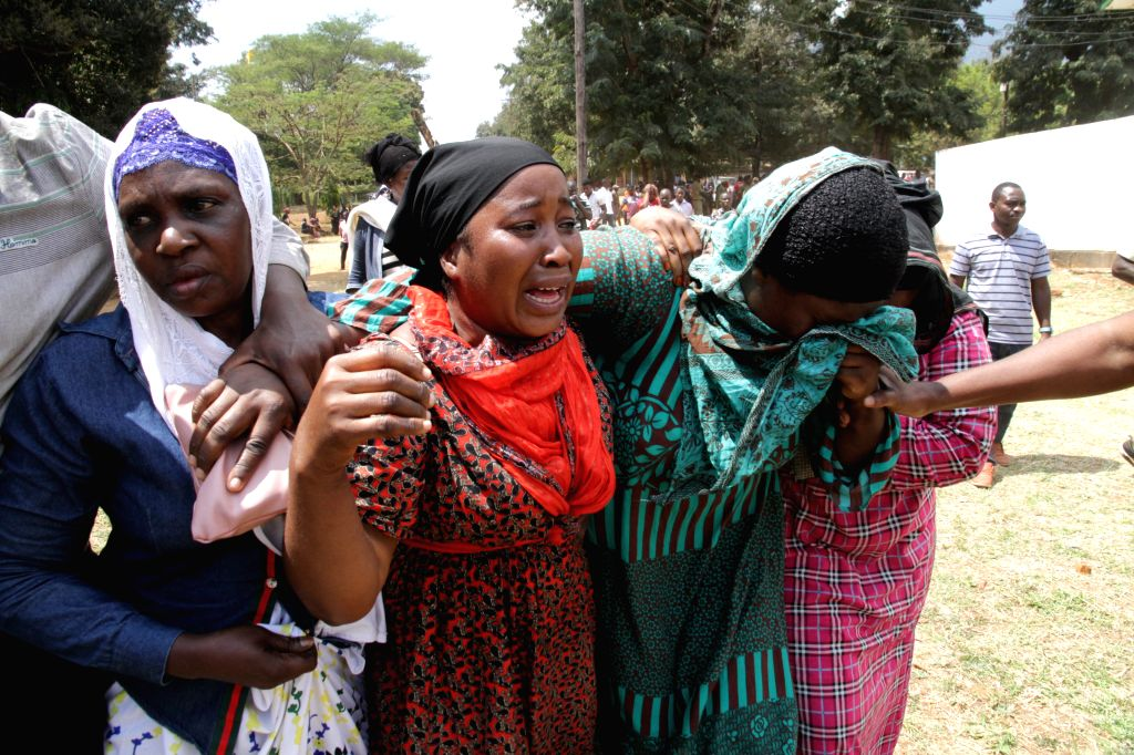 MOROGORO, Aug. 11, 2019 - Relatives of tanker explosion victims cry in a burial ceremony in Morogoro, Tanzania on Aug. 11, 2019. Tanzanian President John Magufuli has declared three days of national ...