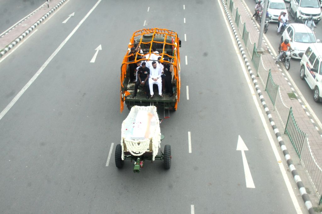 Mortal remains of late BJP leader Arun Jaitley being taken to party headquarters in New Delhi on Aug 25, 2019. - Arun Jaitley