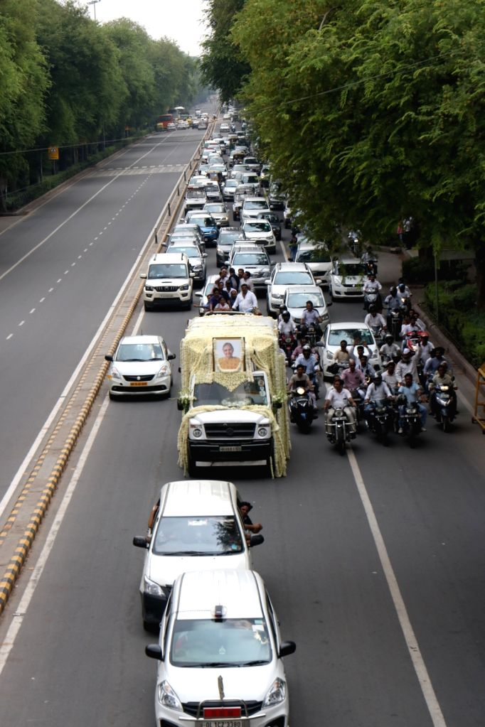 Mortal remains of veteran Congress leader and three-time Chief Minister Sheila Dikshit being taken away from AICC to the Nigambodh Ghat cremation ground for her last rites, in New Delhi on ... - Sheila Dikshit