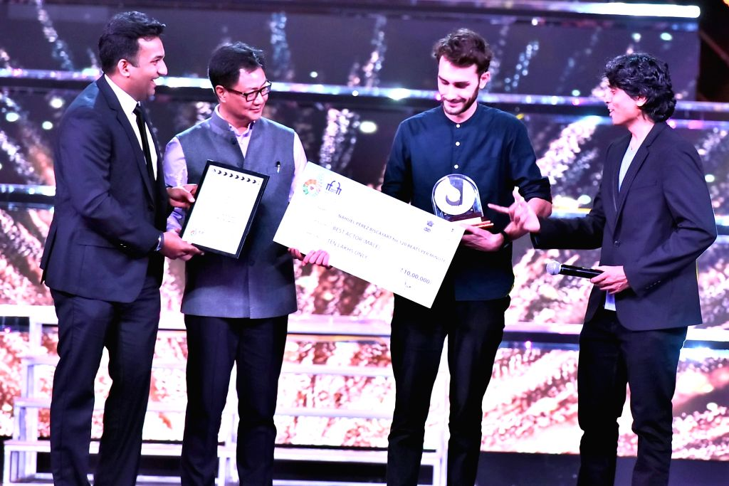 MoS for Home Affairs Kiren Rijiju presents the Silver Peacock Award for the Best Actor (Male) to Nahuel Perez Biscayart for the movie 120 BPM at the closing ceremony of the 48th International ...