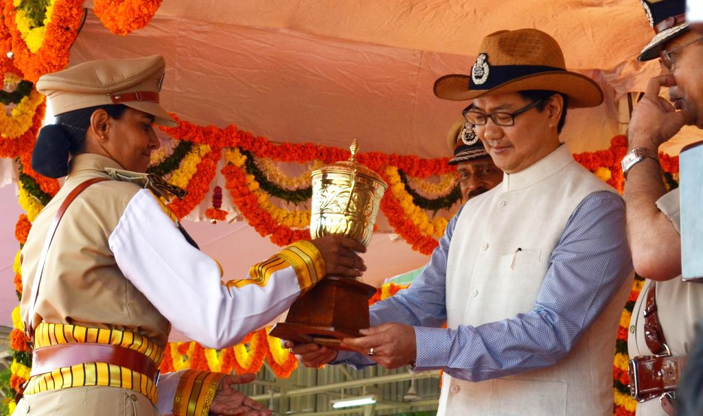 MoS Home Affairs Kiren Rijiju presents the meritorious award to a cadet during Passing Out Parade of 28th batch of assistant commandant(PROB),8th batch Asst.Commandant(DE),40th batch SI/EXE and 1st ..
