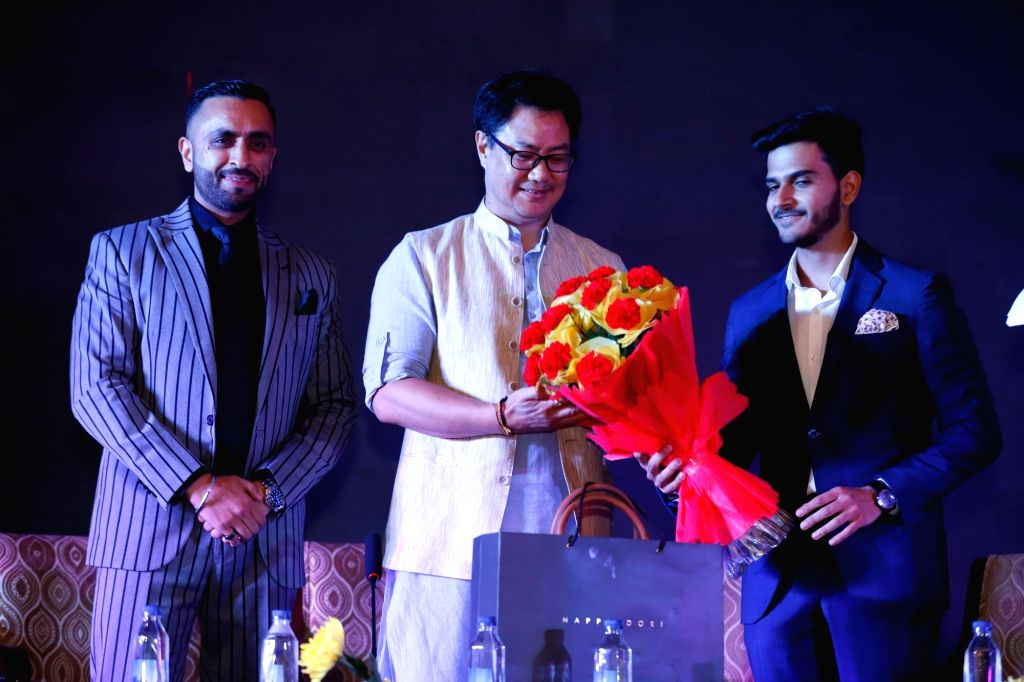 MoS (Youth Affairs & Sports) Kiren Rijiju during a programme organised to unveil a unique concept??? IPLIX Media, in New Delhi on Sep 22, 2019. Also seen Physique Global CEO & ...