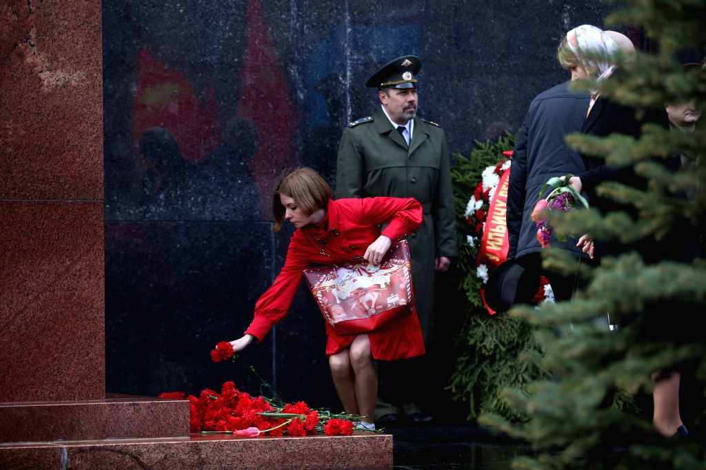 MOSCOW, April 22, 2016 - A woman lays flowers at Lenin's mausoleum in Moscow, Russia, on April 22, 2016. People participated in a laying flower ceremony at the Lenin's mausoleum to mark the 146th ...