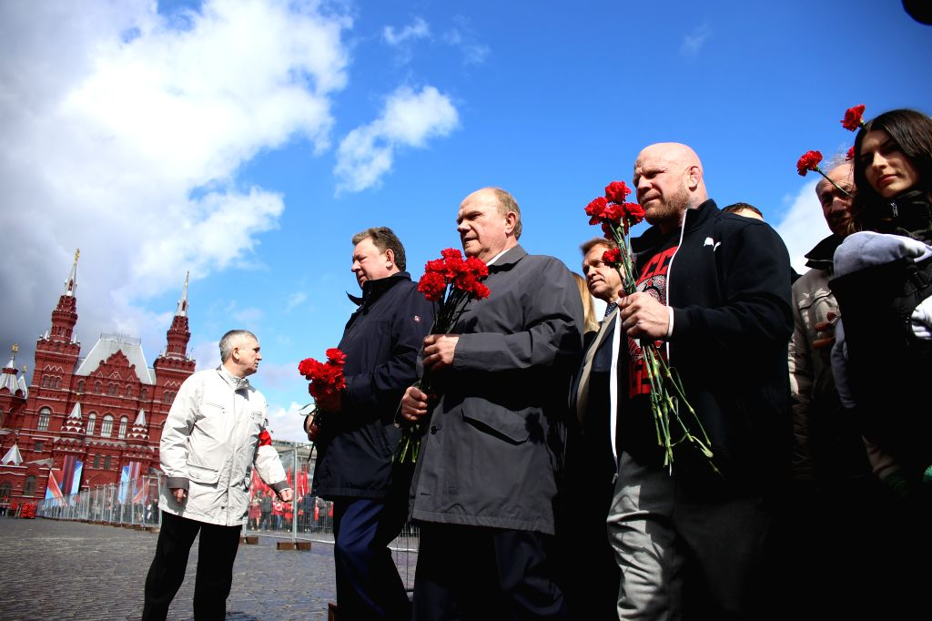 MOSCOW, April 22, 2016 - Gennady Zuganov (3rd, L), leader of the Russian Communist Party, attends a laying flower ceremony at Lenin's mausoleum in Moscow, Russia, on April 22, 2016. People ...
