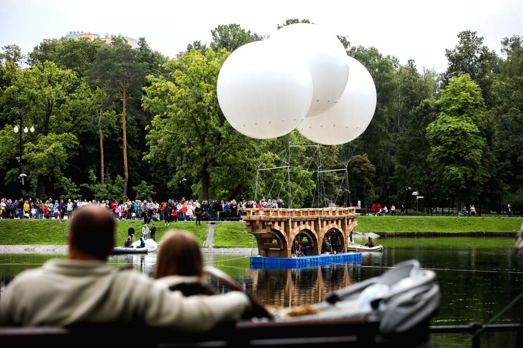 MOSCOW, Aug. 1, 2019 - People look at a flying bridge made of cardboard and duct tape in Ostankino park in Moscow, Russia, on Aug. 1, 2019. A 18-meter-long flying bridge made of cardboard and duct ...