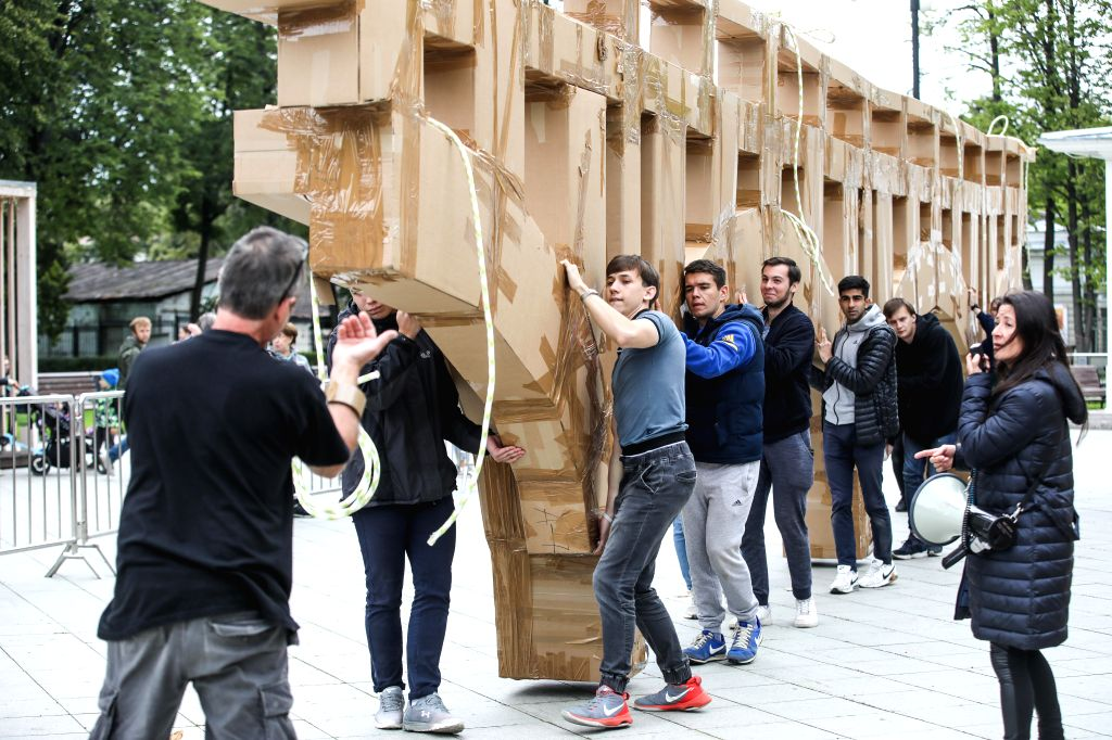 MOSCOW, Aug. 1, 2019 - Volunteers transport a bridge made of cardboard and duct tape in Ostankino park in Moscow, Russia, on Aug. 1, 2019. A 18-meter-long flying bridge made of cardboard and duct ...