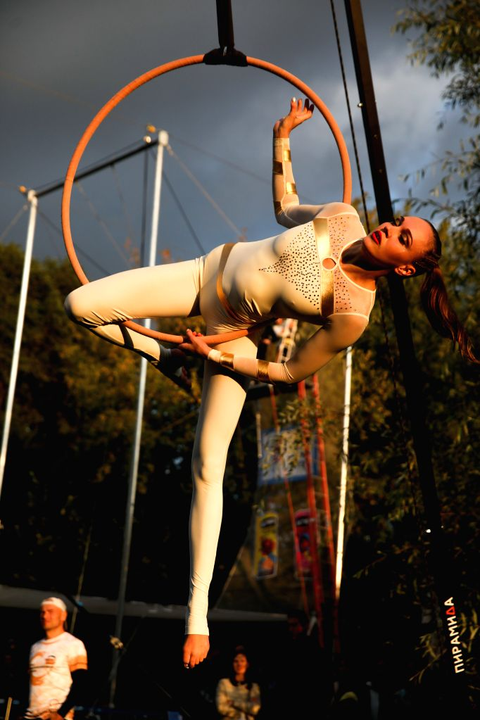 MOSCOW, Aug. 11, 2019 - A gymnast participates in a competition using a ring during an Aerial Gymnastics Festival in Gorky Park, Moscow, Russia, on Aug. 10, 2019. The competition was held in 3 ...