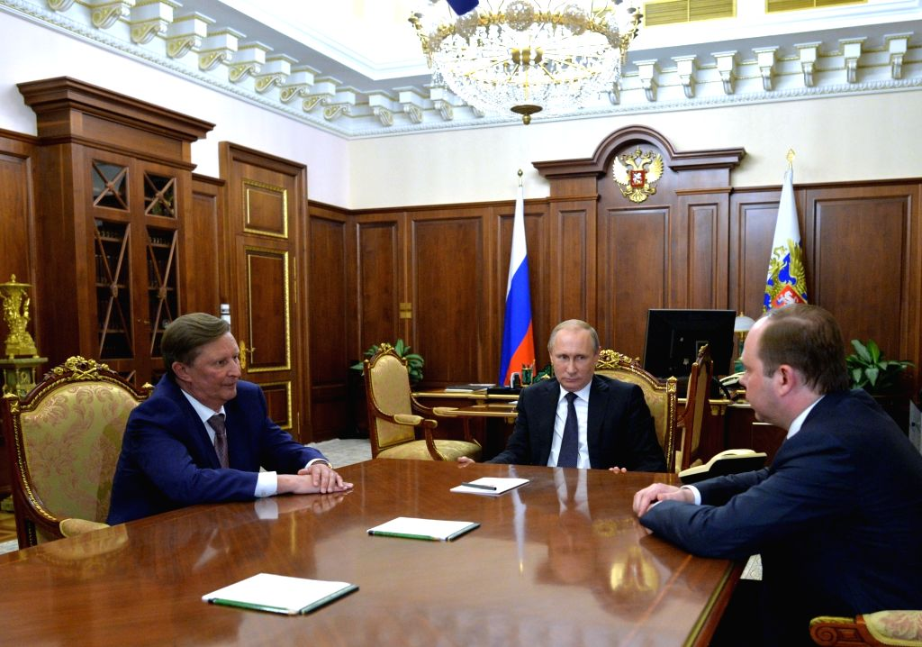 MOSCOW, Aug. 12, 2016 - Russian President Vladimir Putin (C) meets with the newly-appointed head of the presidential administration Anton Vaino (R) and dismissed chief of staff Sergei Ivanov (L) in ...