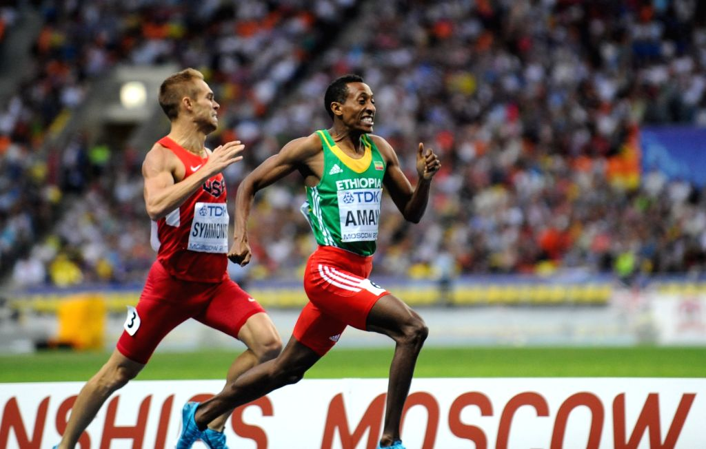 Mohammed Aman (R) of Ethiopia sprints during the men`s 800M final on Day 4 of the 14th IAAF World Athletics Championships Moscow 2013 at Luzhniki Stadium in ...