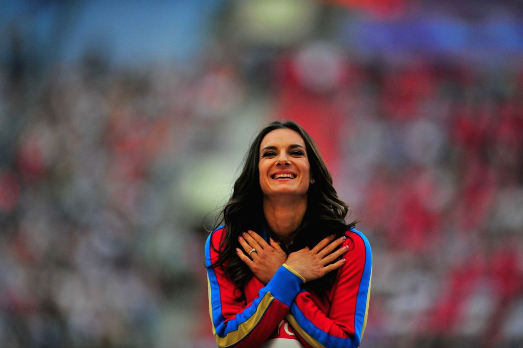 Gold medalist Yelena Isinbayeva of Russia celebrates at the women's pole vault victory ceremony during the IAAF World Athletics Championships at the ...