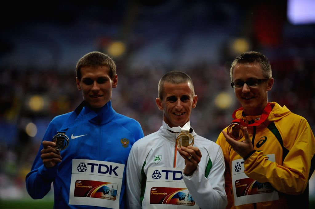 (L-R) Silver medallist Russia's Mikhail Ryzhov , gold medallist Ireland's Robert Hefferman and bronze Australia's Jarred Tallent pose during the