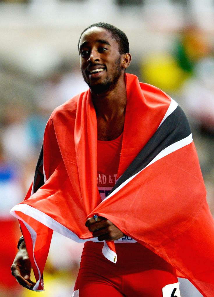 Republic of Trinidad and Tobago's Jehue Gordon celebrates after winning the Men's 400 metres hurdles final at the 2013 IAAF World Championships at ...